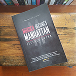 Purchase 'Murder Becomes Manhattan' trade-sized paperbacks.
